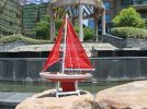 "Wooden It Floats 21"" - Red Floating Sailboat Model with Red Sails"